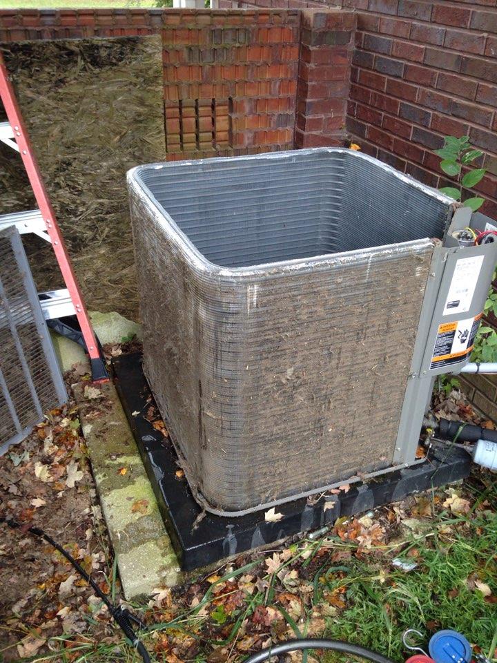 Moulton, AL - Fall maintenance. cleaning a condenser coil on a Lennox heat pump