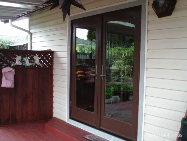Longview, WA - A series out swing door. Cocoa bean/ oak.