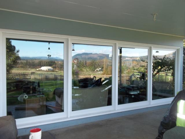 Pleasant Hill, OR - Replacing 14 single pane metal windows. Installing 14 white windows, including seven large tempered picture windows in the living room.