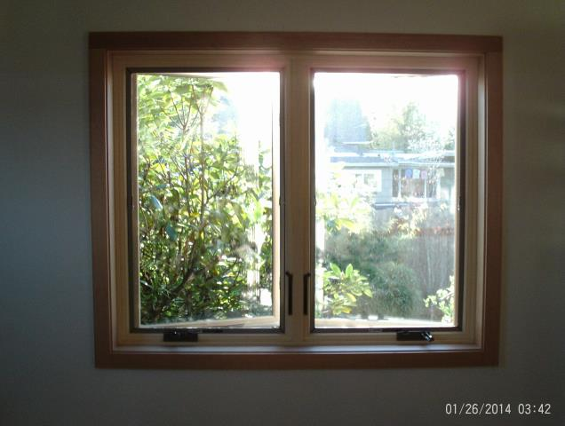 Springfield, OR - Replacing one three panel French door and one casement window. Installing one 2 panel ASG in Red Rock/ Pine with Covington antique brass hardware and footlock, and one Casement in Canvas/Pine with Stone hardware with TruScene screen.