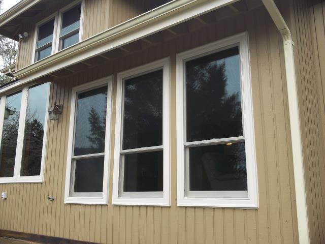Corvallis, OR - Replacing 15 aluminum windows. Installing 15 canvas windows with canvas hardware, SmartSun glass, TruScene screens.