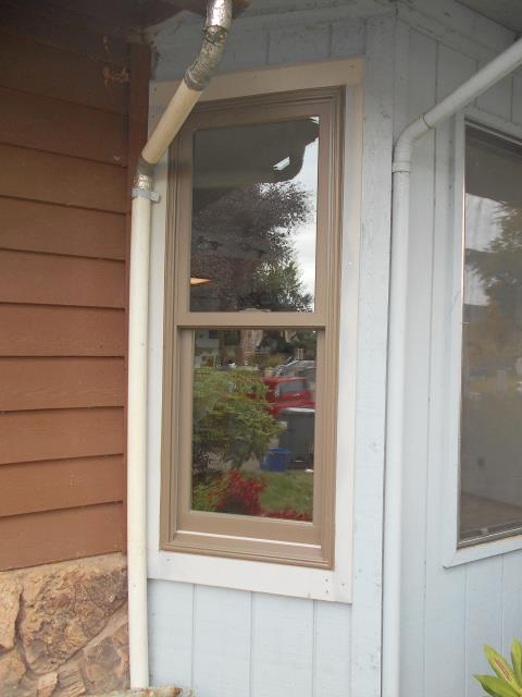 Corvallis, OR - 2 double hung Windows to replace aluminum PW on both sides of a bay window on front of house.