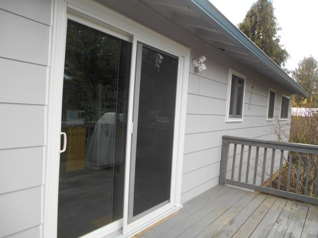 Oregon City, OR - Replaced front triple glider and 6 original aluminum, plus one patio door. White on white