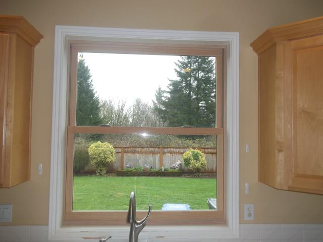Oregon City, OR - Replace original white vinyl. Picture of a double hung windows with oak interior.