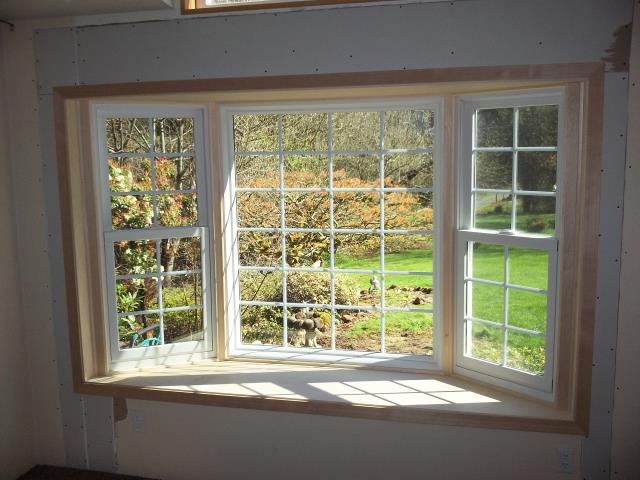 Oregon City, OR - 1 bay window. Pine interior trim, mullions, and seat with single color white windows.
