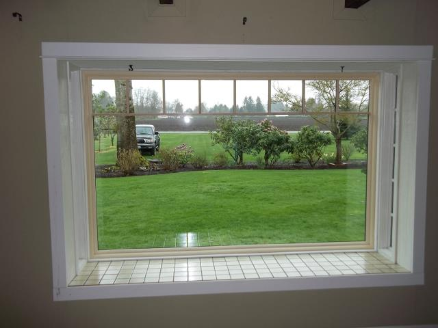 Lake Oswego, OR - 2 basement windows. Picture is of a large picture window with pine interior.