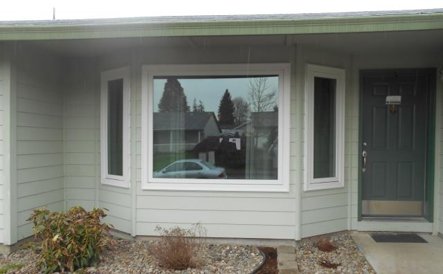 Hillsboro, OR - Replaced 10 vinyl windows and one patio door. Installing 10 white windows and one 2 panel patio door.
