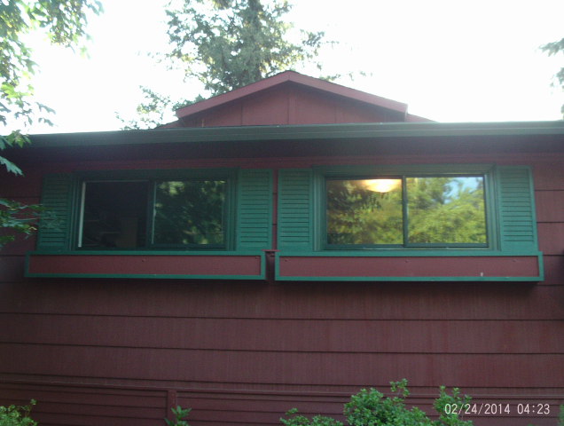 Gresham, OR - 9 windows replaced. Forest green exterior with a white interior.