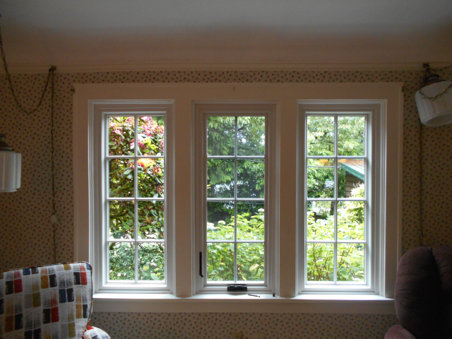 Replaced 21 windows with fibrex windows red rock exterior and white interior.
