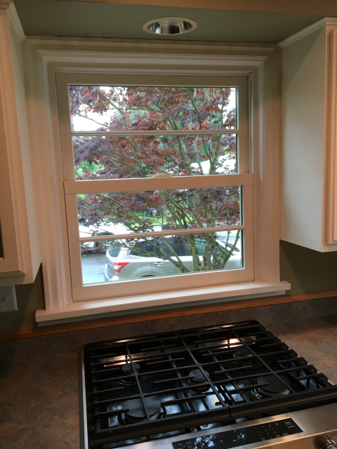 Replaced 8 wood windows with fibrex windows. Picture of interior double hung window.