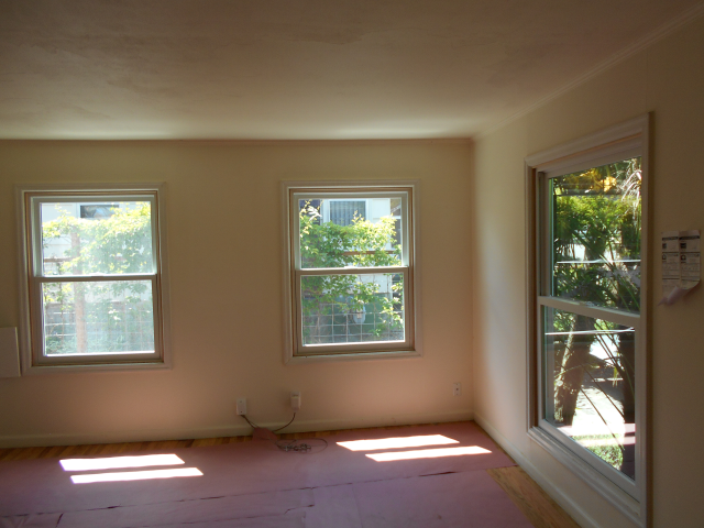 Replace 14 windows total. Picture is of 3 large double hung windows.