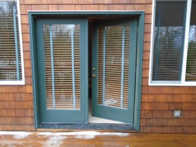 Corbett, OR - Renewal by Andersen installed 2 Fibrex Forest Green Patio doors for this amazing house in Corbett!