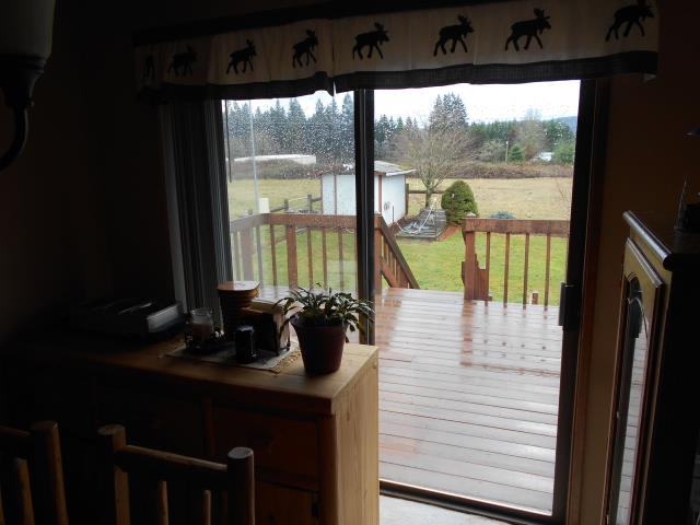 Estacada, OR - Renewal by Andersen enjoyed helping these homeowners with their 7 Window replacement project along with installing a new Fibrex Patio Door!