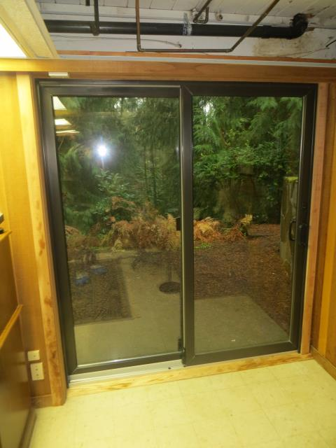 Lake Oswego, OR - We installed a Dark Bronze Gliding Glass Door and a custom window for this lovely house!