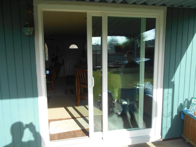 Molalla, OR - Our professional installers worked hard to replace a Gliding Glass patio door for this house!