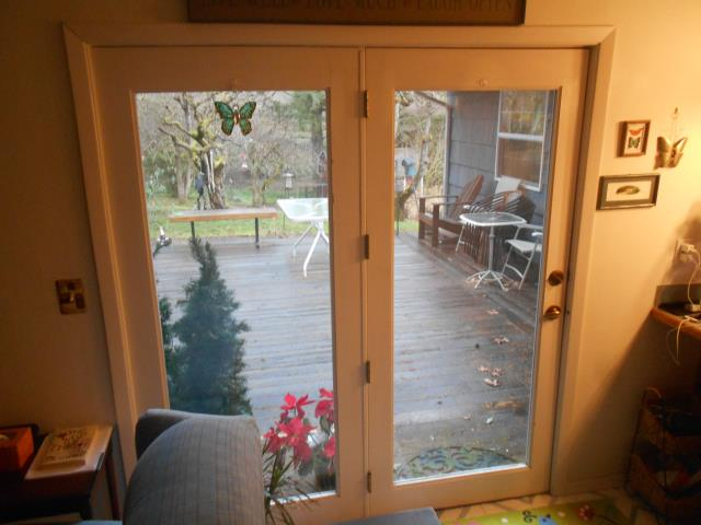 Oregon City, OR - Our professional installers put in a patio door and customized Fibrex window for this house!