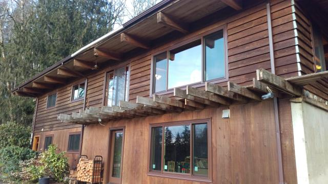 Rainier, OR - Our professional installers worked hard putting Andersen windows for this 19 window replacement home remodeling project along with 2 lovely Patio doors!