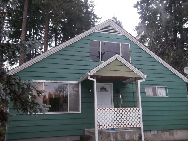Warren, OR - We replaced 12 windows for this home by having our professional install team put in Fibrex Andersen windows!
