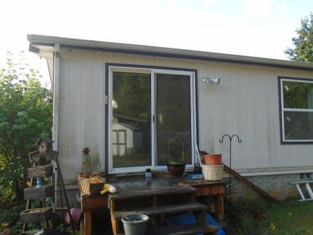 Vernonia, OR - Our professional contractors and install team worked for 5 days taking their time to replace 24 window and a new patio door with Andersen fibrex materials for this home in Vernonia!