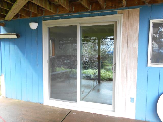 Banks, OR - We installed a beautiful replacement window and patio door for this gorgeous home!