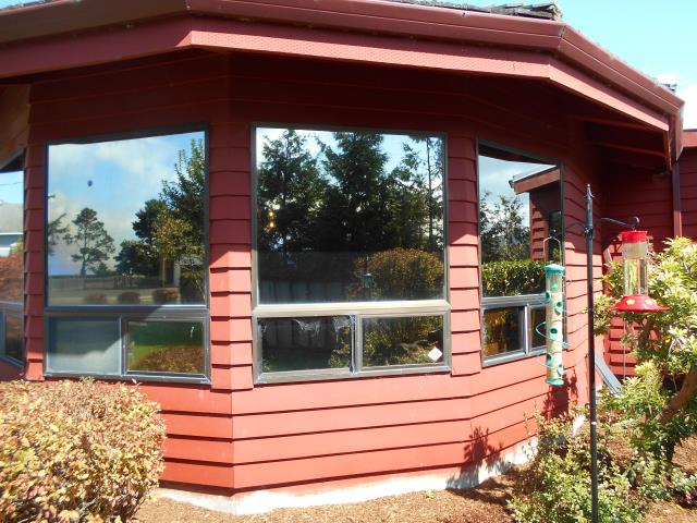 Seaside, OR - We replaced 9 windows with Andersen Fibrex materials and a patio door!