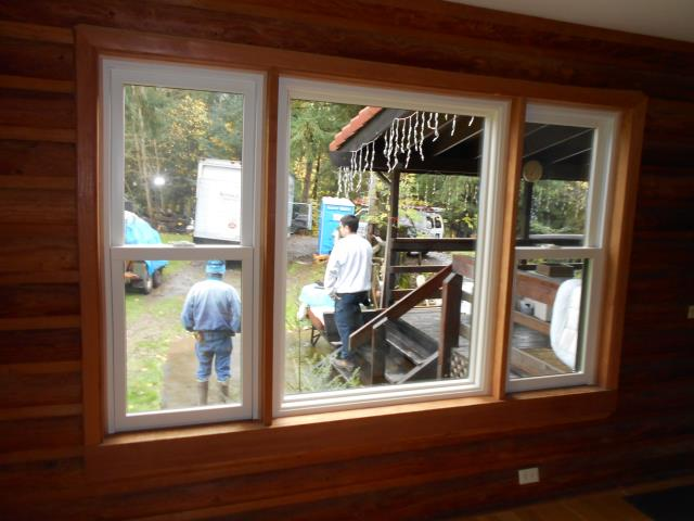 Our installers and taking a step back looking at the beautiful work they did for this home in the 26 window replacement for this gorgeous home in Salem.