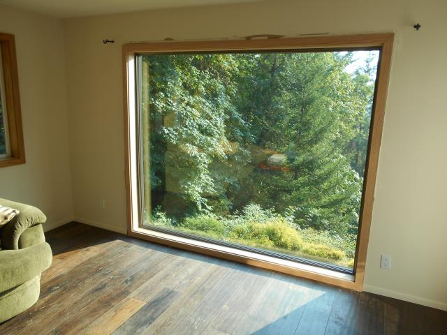 We installed 13 replacement windows for this Hillsboro home including this lovely picture window with a perfect view outside!
