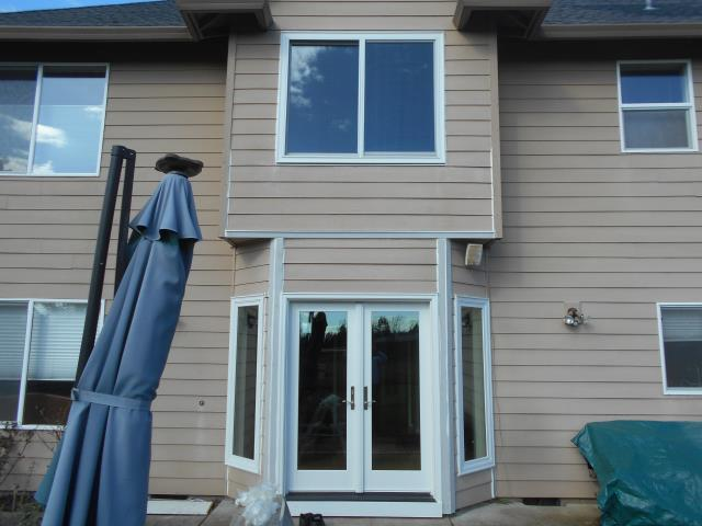 We installed 3 replacement windows and a patio door for this gorgeous Battle Ground home!
