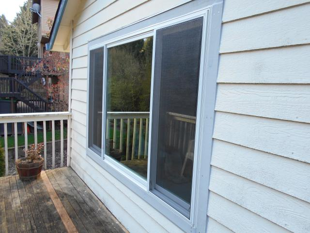 Aloha, OR - Our certified window installation crew put in 7 replacement windows from Renewal by Andersen including a sliding glass patio door replacement.