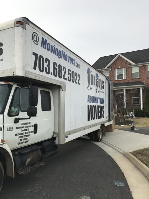 Frederick, MD - Our Guys providing a move of household goods from a storage locker into a house.