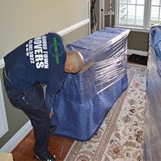Herndon, VA - protecting a piece of furniture in the house.