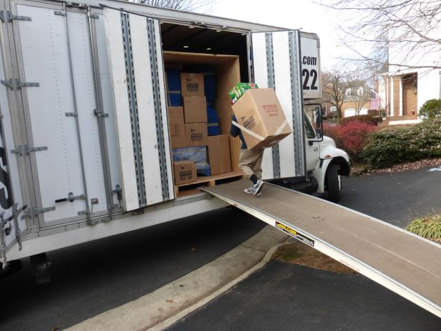 McLean, VA - Loading a truck for storage.