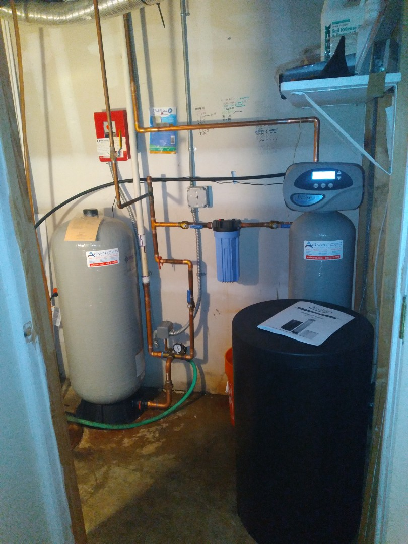 Well tank, water softener, and sump pump