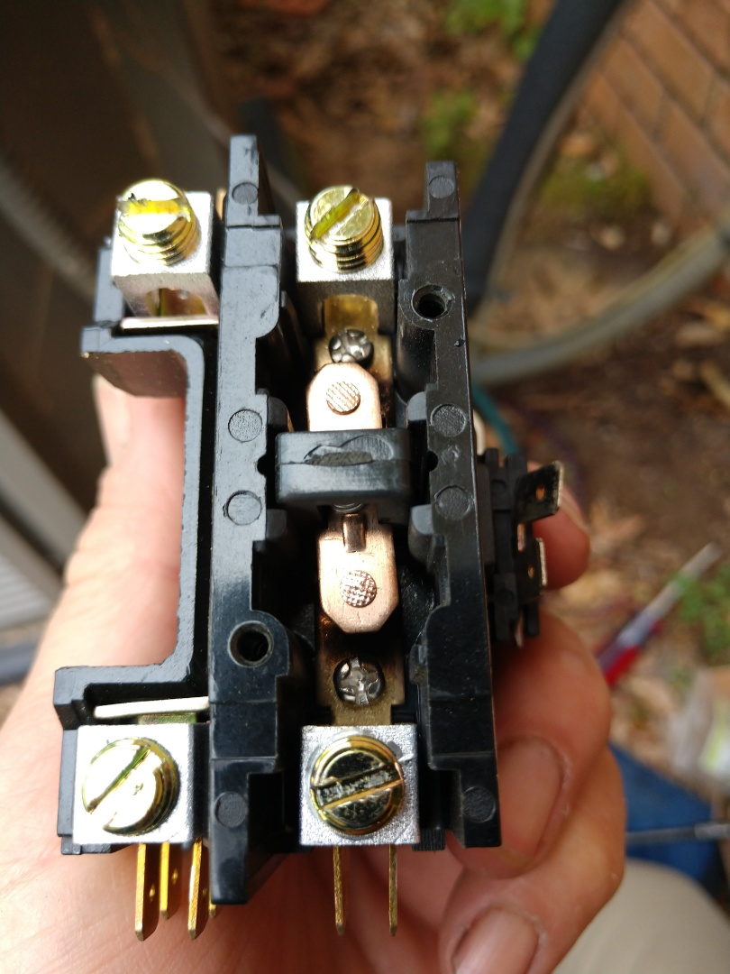 Replaced burnt contactor on air conditioner check-up.