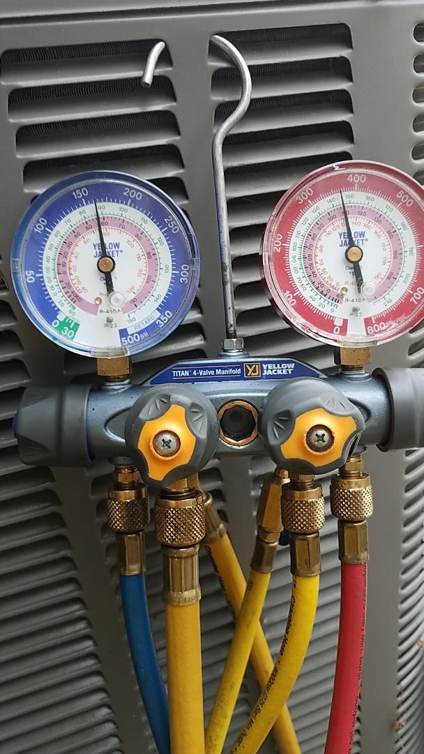 Checking system refrigerant pressures on Lennox heat pump in Prattville