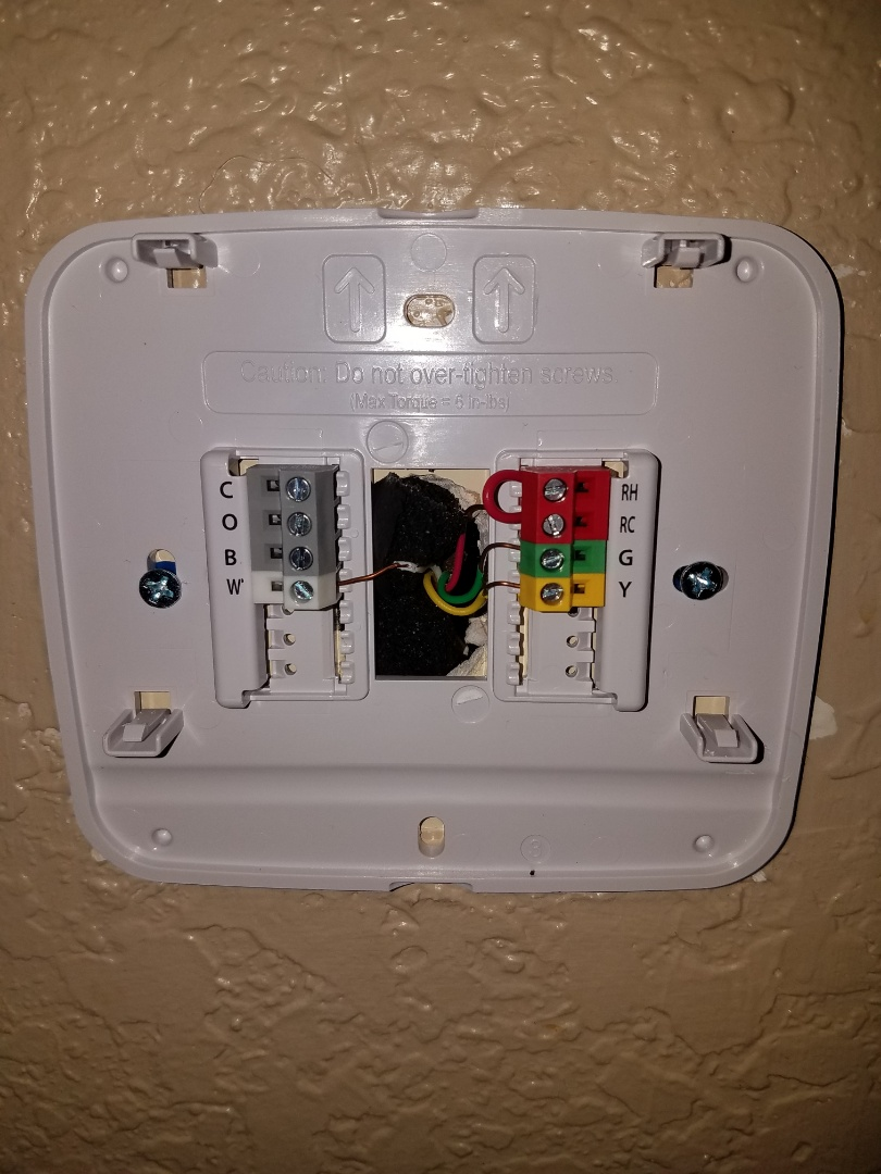 Added insulation behind new thermostat installation