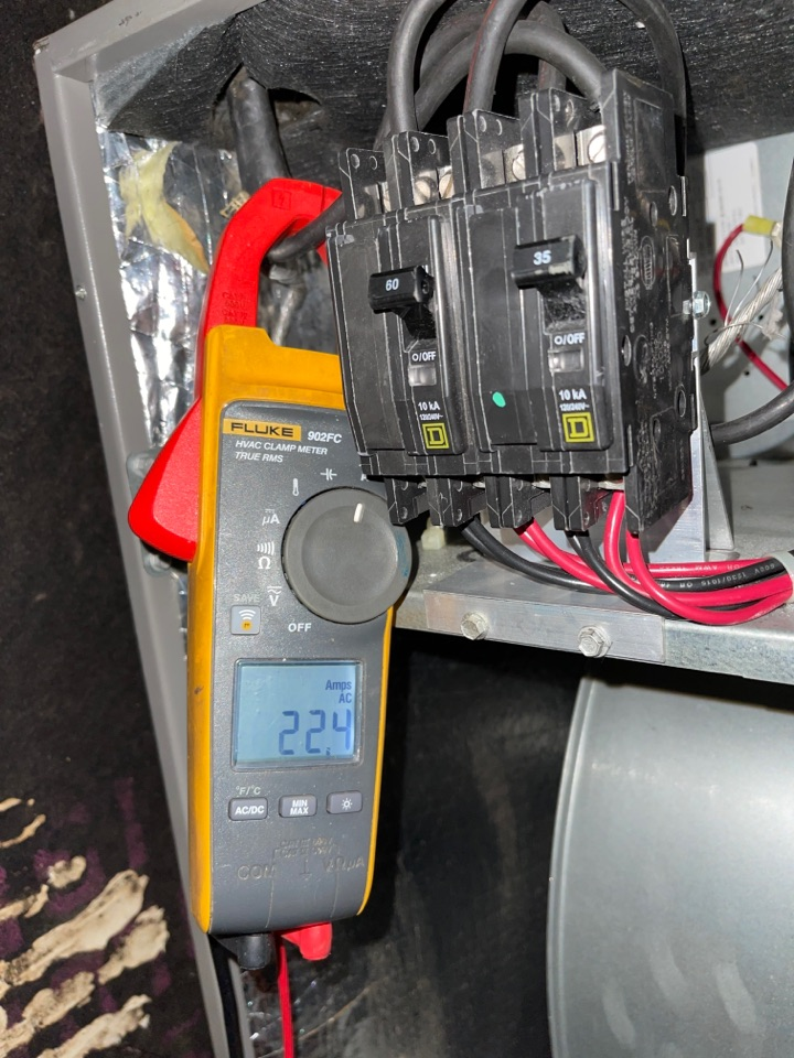 Checking heat strip amperage on air handler during routine preventative heating and cooling maintenance