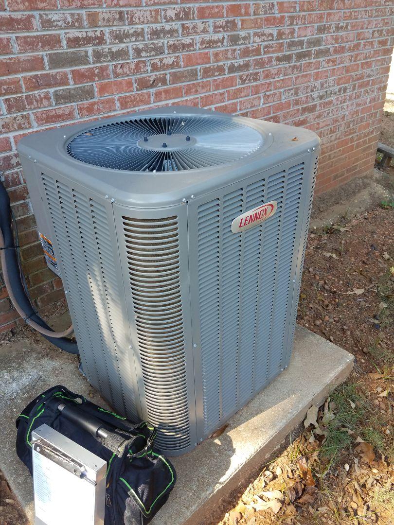 Deatsville, AL - Checking Lennox condenser during routine maintenance in Deatsville