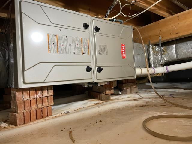 Bowling Green, KY - Late Spring Furnace installation Bowling Green, KY.  Bryant 95% AFUE 915 Series Furnace replacing a Heil 80% AFUE NTC Series Furnace.  The energy efficient fan motors in these new Bryant furnaces improve the air conditioning efficiency.  Crawlspace Installation.