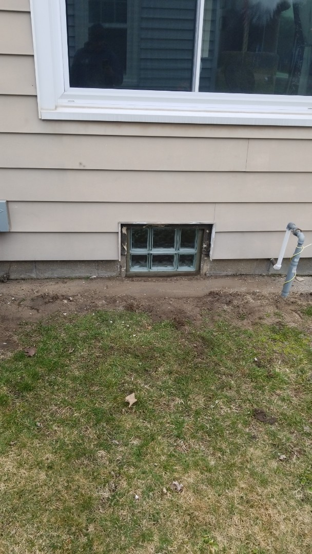 Holland, MI - Replace old coal chute with new Glass block window