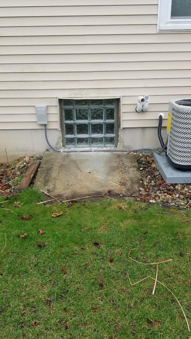 Install new glass block window in basement