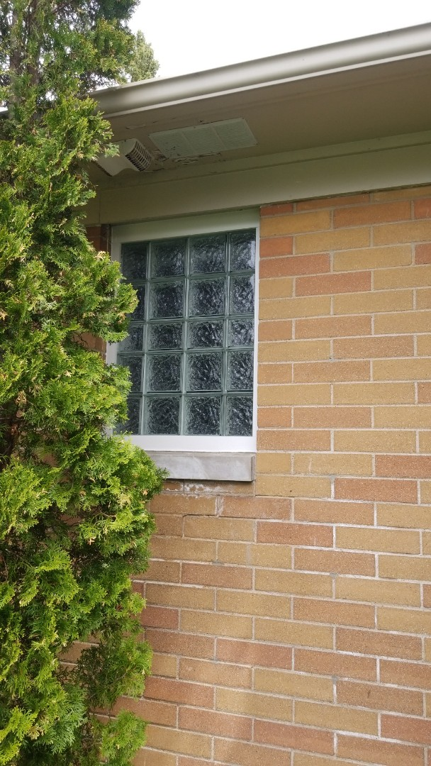 Grand Haven, MI - Install new glass block window in bathroom and trim the outside