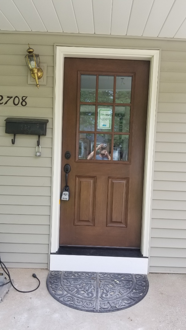 Install new front entrance door