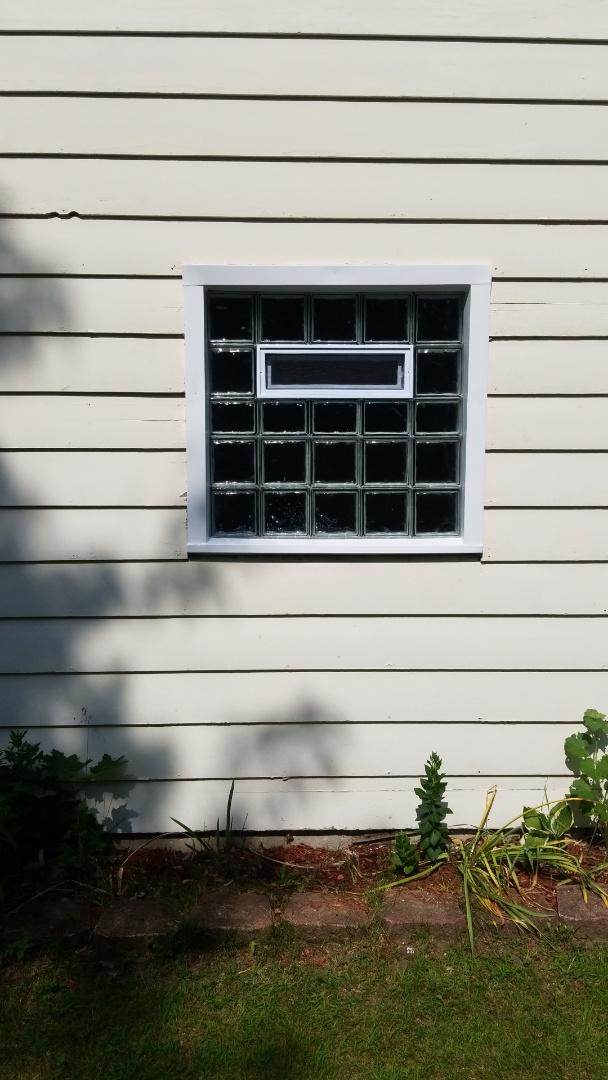 Wrap glass block window in garage