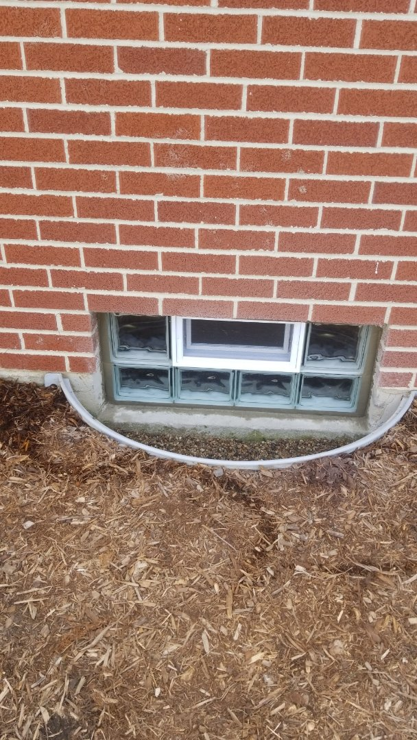 Install two new lintels and replace three glass block windows