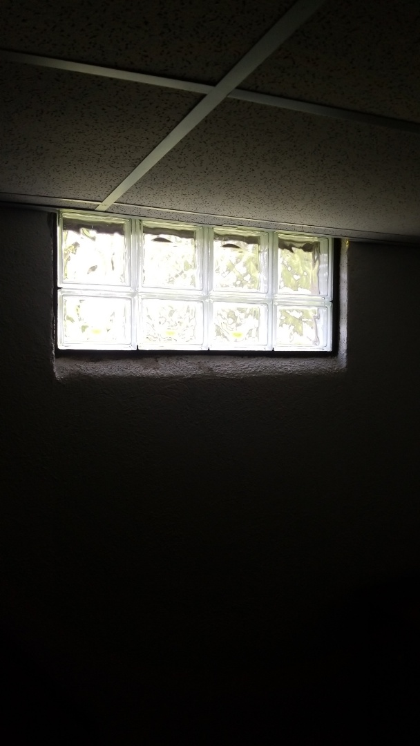 Install 7 new glass block windows in basement to replace old broken windows