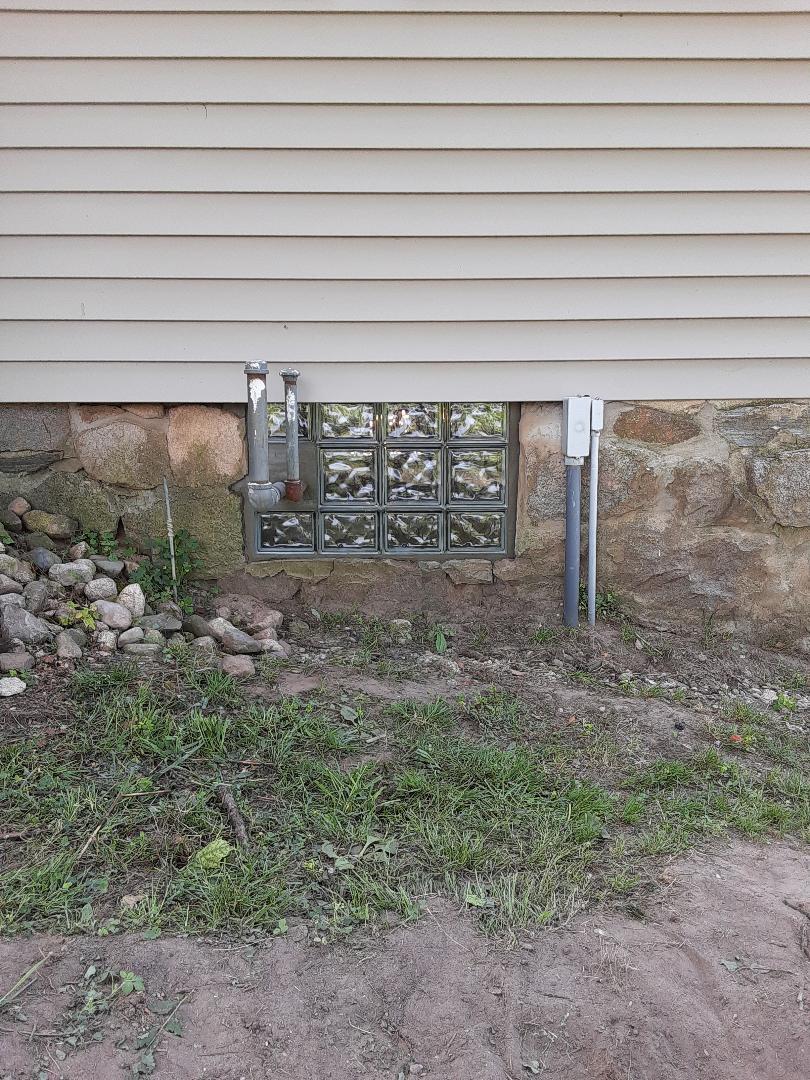 Glass block basement window custom made for pipes running through.