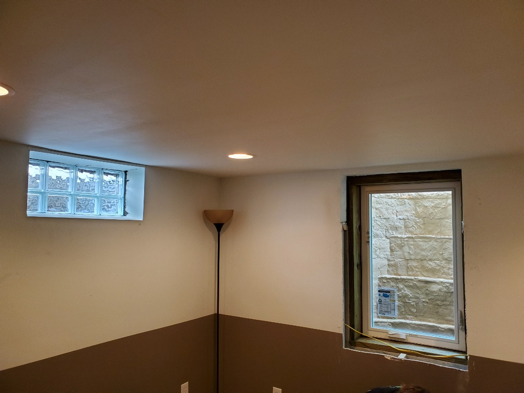 Install glass block windows and an egress window system at home