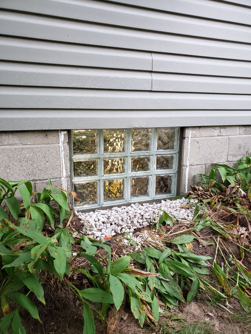 Muskegon, MI - Replacement of of old single pane basement windows with energy efficient glass block windows in muskegon.  Customer was happy and satisfied.