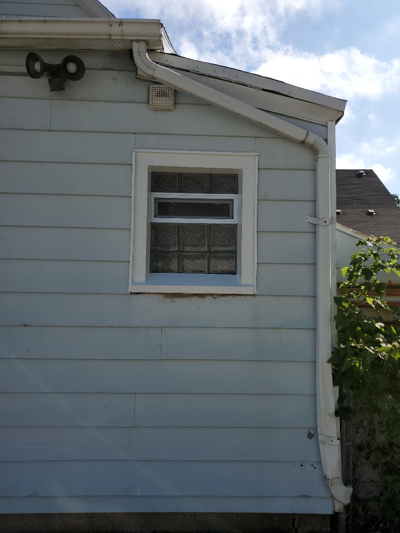 Grand Rapids, MI - Install new glass block window with a fresh air vac and homeowners bathroom shower